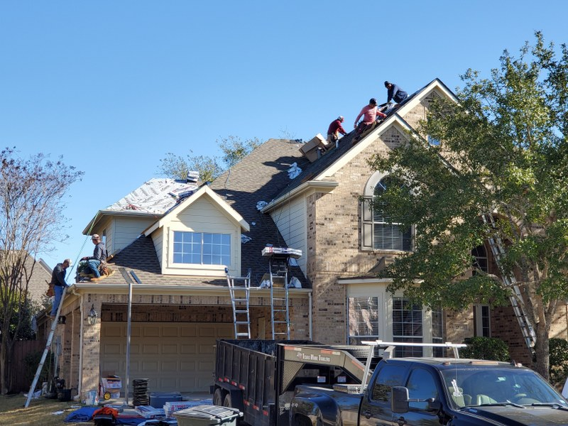 ck roofing working on a new roof in houston tx