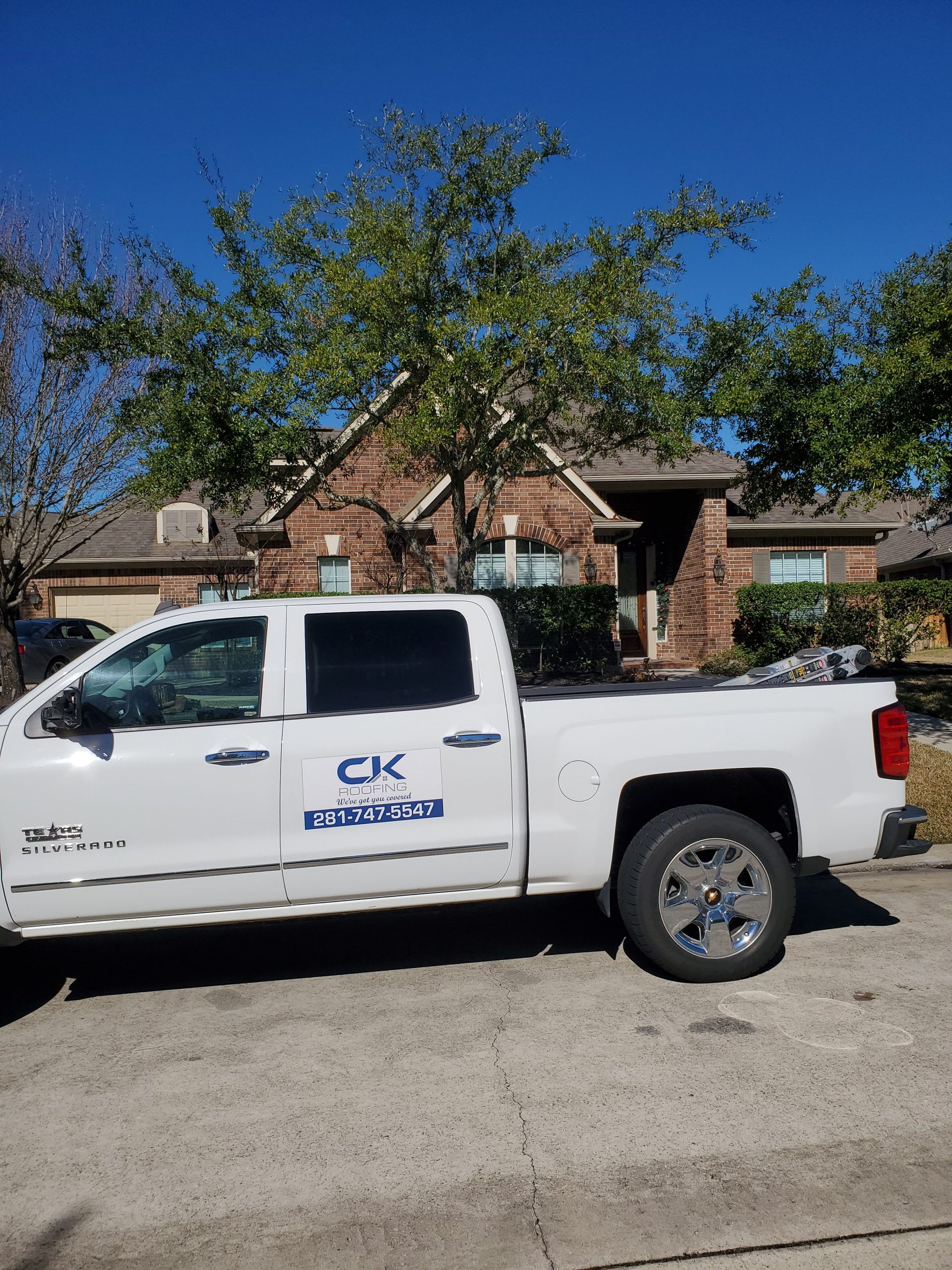 CK roofing truck in front of a house